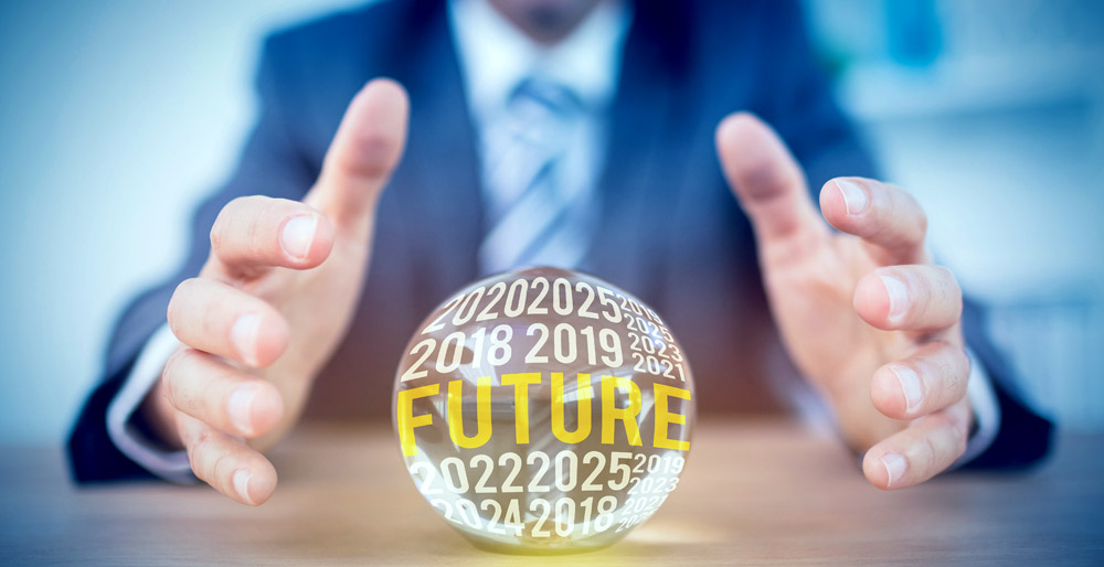 man using crystal ball to forecast future of surveys