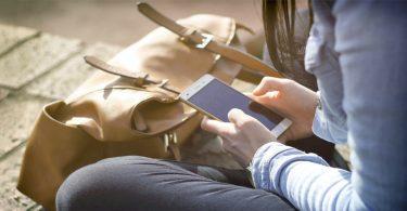 Woman taking TGM Surveys on her phone