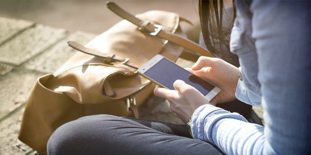 Woman taking surveys on her phone