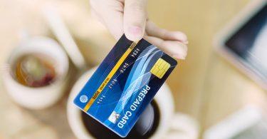 Woman's Hand Holding Prepaid Visa Card