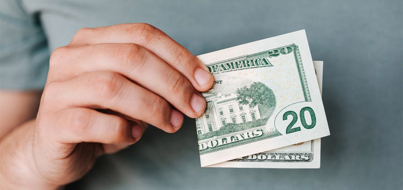 Man holding a 20 dollar bill