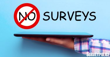 No surveys text above person holding tablet