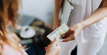 Market research participant receiving a $10 bill