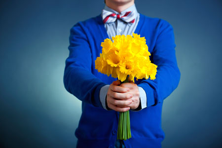 boy holding flowers