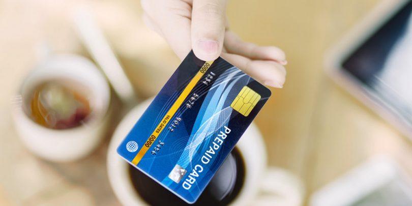 Woman holding prepaid credit card