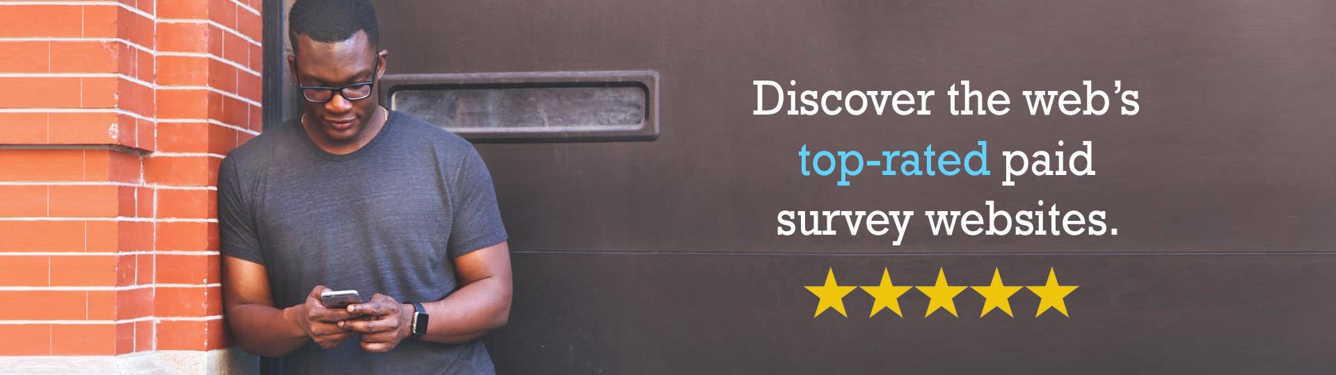 Man looking at phone taking surveys